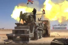 Newly arrived flatbed-mounted artillery counters an ISIS attack near Humaymah.