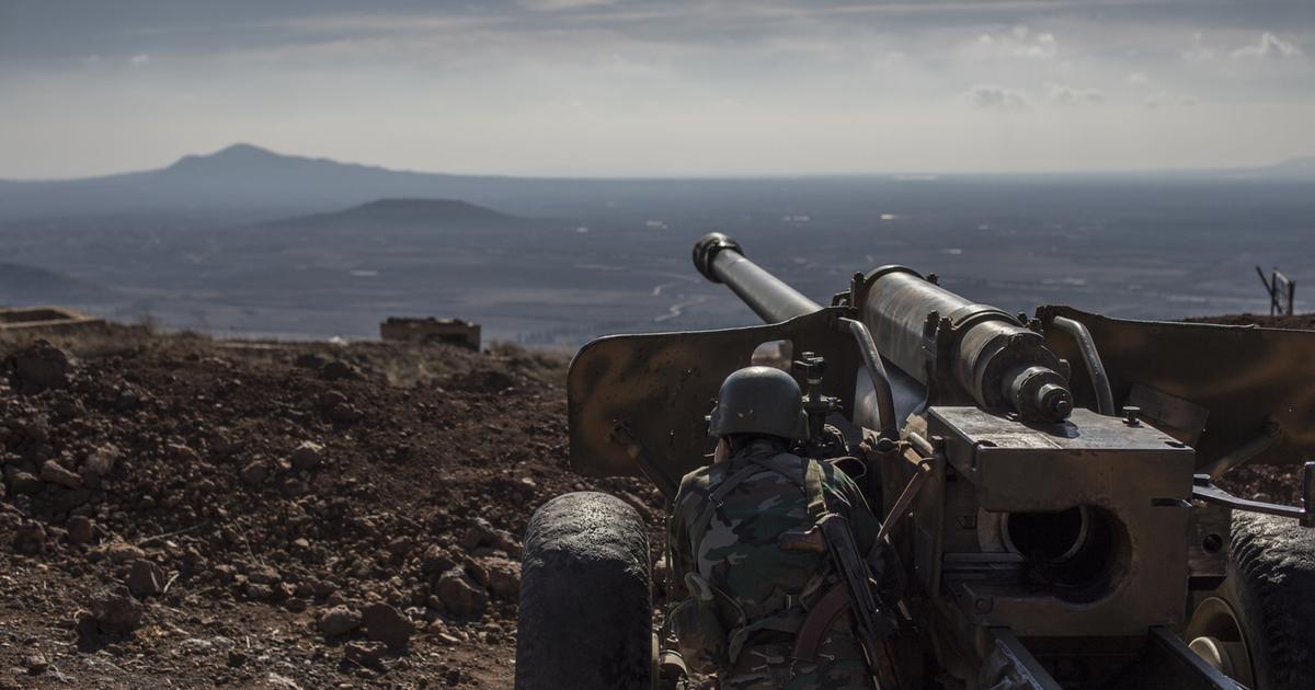 Syrian army Kurdish Soldier mans an artillery piece in Quneitra