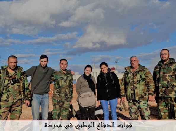 Members of the French far-right Christian NGO SOS Chrétiens d'Orient pose with NDF fighters from Mahradah.