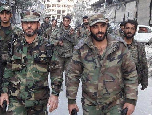 سليمان الحايك على اليمين في حلب بتاريخ 12 كانون الأول