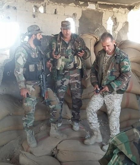 Suleiman Shaheen (right) with Colonel Yunis Mohammad (center) in Deir Ez Zor.