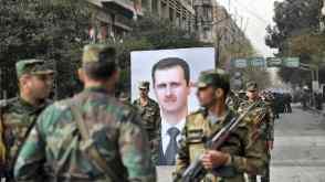 Assad and militia men