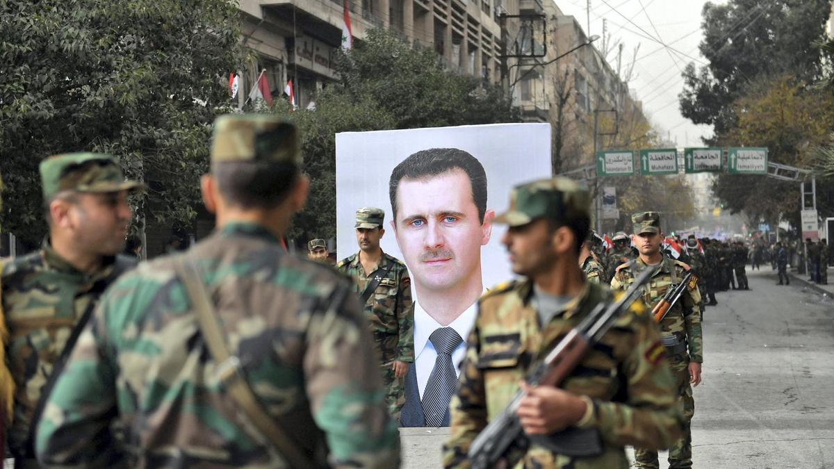 Assad and militia men